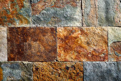 Kritisera färgrika texturtegelplattor för stenen Royaltyfri Bild