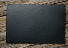 Kritisera över gammal träbakgrund Arkivbilder