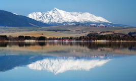 Krivan peak reflected in Liptovska Mara royalty free stock photography