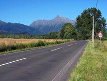 Krivan Peak and road at summer stock photos