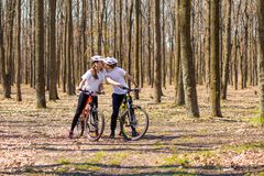 Krivoy Rog, Ukraine - April 9, 2019: Happy couple riding bicycles outside, healthy lifestyle fun concept. exercise togethe stock photo