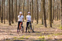Krivoy Rog, Ukraine - April 9, 2019: Happy couple riding bicycles outside, healthy lifestyle fun concept. exercise togethe royalty free stock images