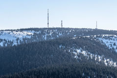 Krizava and Velka luka hills with communication towers in winter Mala Fatra mountains in Slovakia Stock Photo