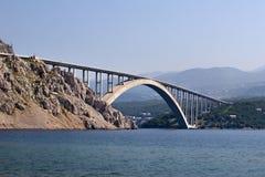 Krk bridge. Bigger arch of bridge Krk, view from water level royalty free stock photography