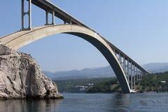 Krk bridge. Bigger arch of bridge Krk, view from water level stock photos
