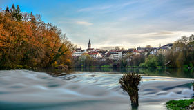 Krka river and city  Novo mesto. Krka river with the city Novo mesto in the background and blue sky, beautiful scenery Stock Images