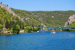 Krka river. Cruise ship on the background of the bridge on the river Krka in Croatia Stock Images