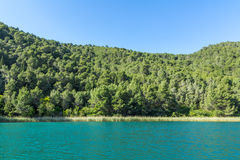 Krka river and forested hills. Krka national park, Croatia - May 05, 2016: Krka river and forested hills Royalty Free Stock Photo