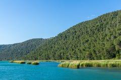 Krka river and forested hills. Krka national park, Croatia - May 05, 2016: Krka river and forested hills Stock Photo