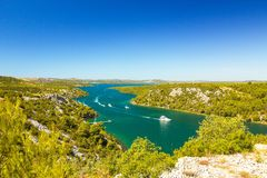 Krka river, near city Skradin in Croatia. Sailboats sailing on the river Royalty Free Stock Photo