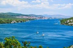 The Krka river. Yachts on the Krka river against the Sibenik cityscape background, Croatia stock photo
