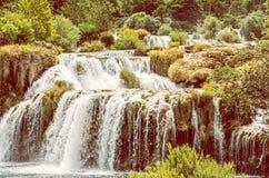 Krka siklawy, chorwacki park narodowy, koloru żółtego filtr Fotografia Royalty Free