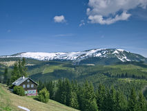 Krkonose mountains. Panoramic view of krkonose mountains with chalet Stock Photos