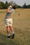 körning av golfområde Arkivfoto