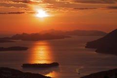 Kroatië: Rode zonsondergang stock afbeeldingen
