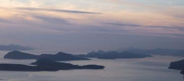 Kroatiska öar på skymning Fotografering för Bildbyråer