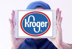 Kroger stores logo. Logo of kroger stores on samsung tablet holded by arab muslim woman Royalty Free Stock Image