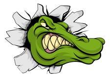 Krokodil- eller alligatorhuvud som bryter till och med väggen Arkivbild