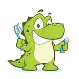 Krokodil oder Alligator, die Zahnbürste und Zahnpasta halten Stockfoto