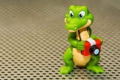 Krokodilfotograf som en leksakpojke arkivbilder