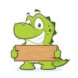 Krokodyl lub aligator trzyma deskę drewno Zdjęcia Stock