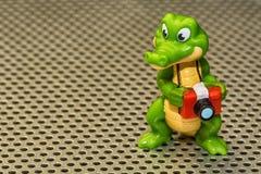 Krokodyla fotograf jako zabawkarska chłopiec zdjęcie stock