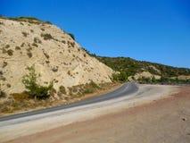 Krommeweg op woestijn Royalty-vrije Stock Afbeelding