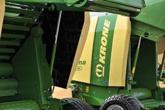 Krone tractor and logo. Kaunas, Lithuania - March 23: Krone tractor and logo on March 23, 2018 in Kaunas, Lithuania. Maschinenfabrik Bernard Krone GmbH is one of Stock Photo