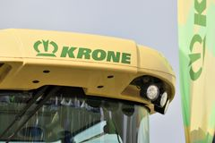 Krone tractor and logo. Kaunas, Lithuania - March 23: Krone tractor and logo on March 23, 2018 in Kaunas, Lithuania. Maschinenfabrik Bernard Krone GmbH is one of Royalty Free Stock Photography