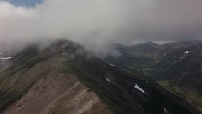 Kronotsky Nature Reserve on Kamchatka Peninsula. View from helicopter stock footage video stock footage