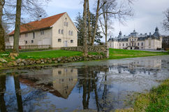Kronovall's castle with water reflection. Kronovall's castle with storage house Stock Image