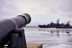 Kronstadt city river water reflection sky outdoors waterfront harbor embankment ship gun Royalty Free Stock Photos