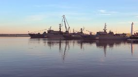 The ships of the Baltic Navy in the Harbor, evening. Kronstadt, Russia stock video footage