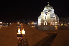 Kronstadt. Russia. View of the eternal flame and the Naval Cathedral. Royalty Free Stock Photography