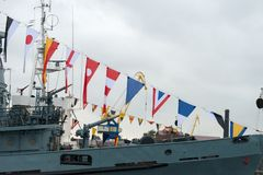 Flags of the international code of signals. KRONSTADT, SAINT PETERSBURG, RUSSIA - AUGUST 21, 2017: warships docked in Peter the great middle harbour Stock Photos