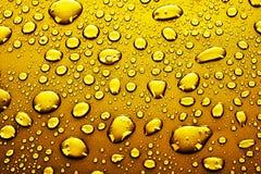 kropel złota woda Zdjęcie Stock