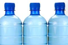 kropelki butelkowa woda Fotografia Stock