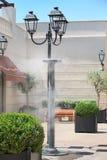 Kropidła bryzga vaporized wodę przy ulicą cool gorącą lato temperaturę po to, aby Zdjęcie Royalty Free