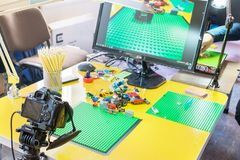 KROPIVNITSKIY, UKRAINE – 12 MAY, 2018: Stop motion animation p. Rocess with Lego details and toy cars. Computer monitor, stop motion elements to create royalty free stock image