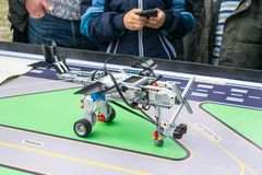 KROPIVNITSKIY, UKRAINE – 07 OCTOBER, 2017: Robotics lessons. B. Oys and girls construct and programming code Robot Lego Mindstorms EV3. STEM education royalty free stock photography
