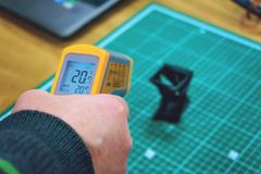 Free Kropivnitskiy, Ukraine – 12 May, 2018: Laser Thermometer. Yellow Pyrometer In Man Hand. Pyrometer, Device For Measuring Royalty Free Stock Images - 149795619