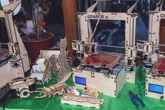 KROPIVNITSKIY, UKRAINE 12 MAY, 2018: Plywood 3D printer graber i3. Wooden Three dimensional printing machine and various 3D. KROPIVNITSKIY, UKRAINE stock images