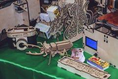KROPIVNITSKIY, UKRAINE  12 MAY, 2018: Plywood 3D printer graber i3. Wooden Three dimensional printing machine and various 3D. KROPIVNITSKIY, UKRAINE stock photography