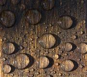krople nawadniają drewno Zdjęcie Stock