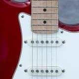 Kropp av den elektriska gitarren med snaror och uppsamlingar arkivfoto