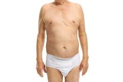 Kropp av en äldre man i underkläder Arkivfoto