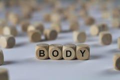 Kropp - kub med bokstäver, tecken med träkuber royaltyfria foton