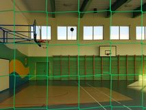 Krosno Polen - kan 27, 2018: Gymnastisk multifunctional korridor i gröna färger med ett basketfält och ett raster på fönstren fo Fotografering för Bildbyråer