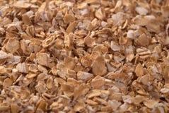 krossad oatmeal för bakgrund Arkivfoton