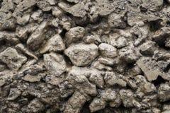 Krossad sten för textur i den gamla betongen arkivbild